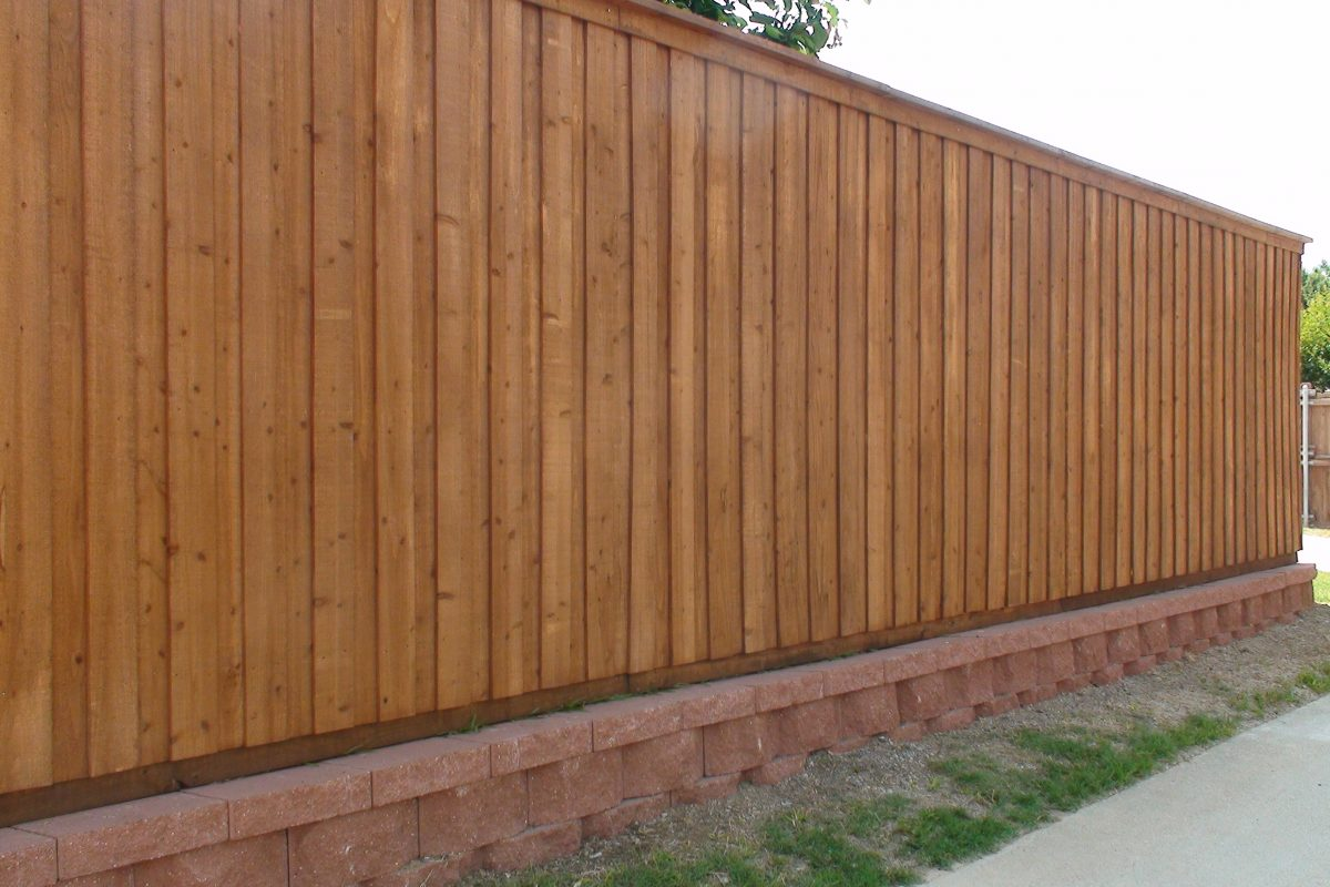 902 - Red paver retaining wall & board on board fence
