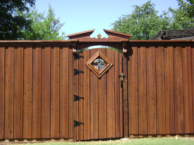 103 - Board on board fence with pediment, corbels & insert