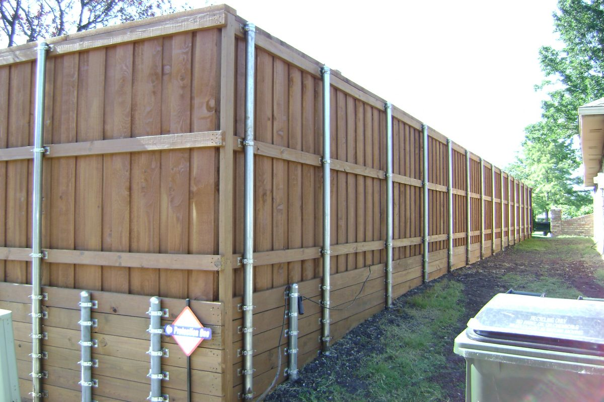 Wood fences installation construction fence max texas 133 fence retaining wall short baanklon Gallery