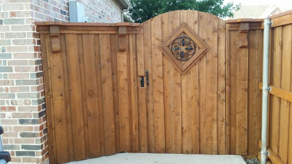 138 - 6 foot board on board fence with arched gate