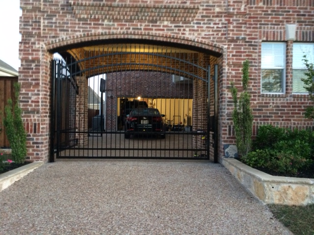 313 - Iron electric gate - inside arched brick