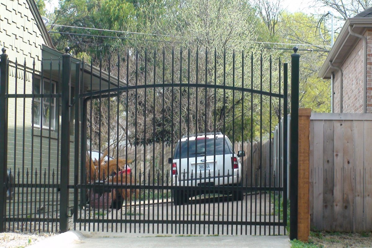324 - Iron electric swing gate - extended pickets, finials & puppy panels