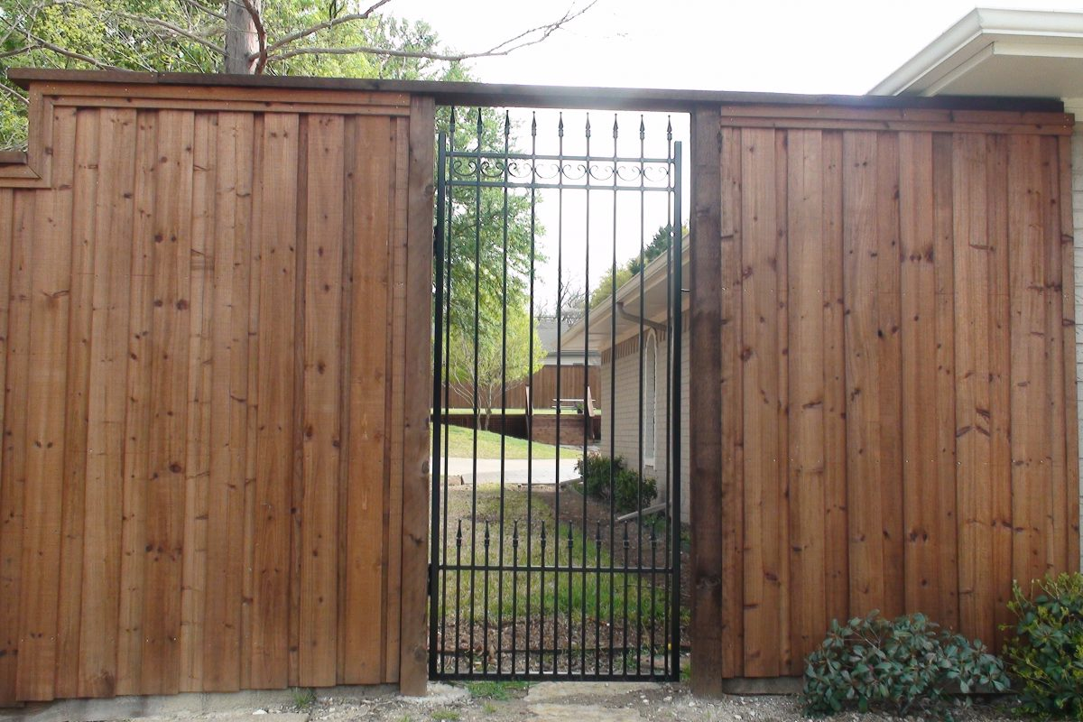 605 - Custom iron walk in gate on b_b wood fence