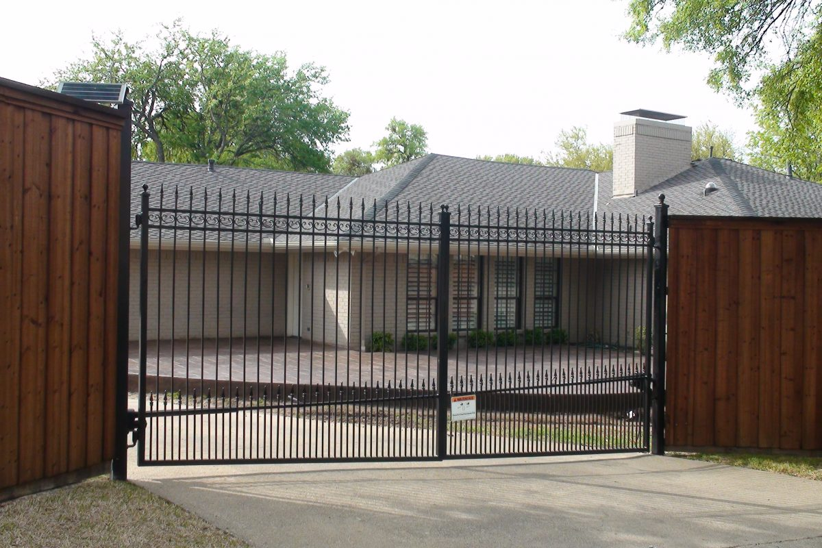 607 - Custom double iron swing gate - extended pickets. finials, puppy panels & b_b wood fence with double trim 2
