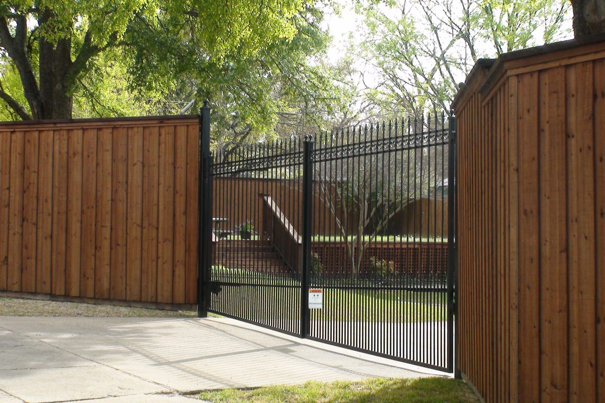 608 - Custom double iron swing gate - extended pickets. finials, puppy panels & b_b wood fence with double trim