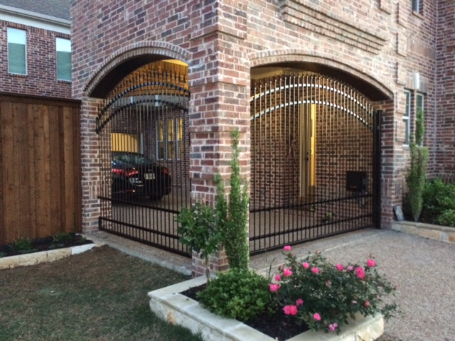 609 - Custom iron panel and electric swing gate